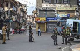 Security personnel stand guard during restrictions...- India TV