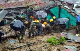Fire and police personnel attempt to rescue a person...- India TV