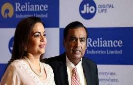 RIL Chairman Mukesh Ambani (right) with wife Neeta Ambani- India TV