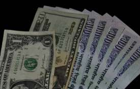 Rupee reverses gains to close nearly flat at 71.71 against US dollar- India TV
