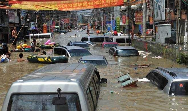 चीन में बाढ़ के कारण कम से कम 18 लोगों की मौत - India TV