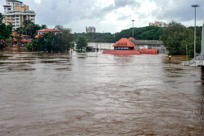 Kochi: Aluva Mahadeva Temple is seen submerged in the water following a flash flood, triggered by he