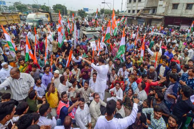 Youth Congress activists hold at a protest during 'Bharat Bandh', called against fuel price hike and depreciation of the rupee, in Ahmedabad