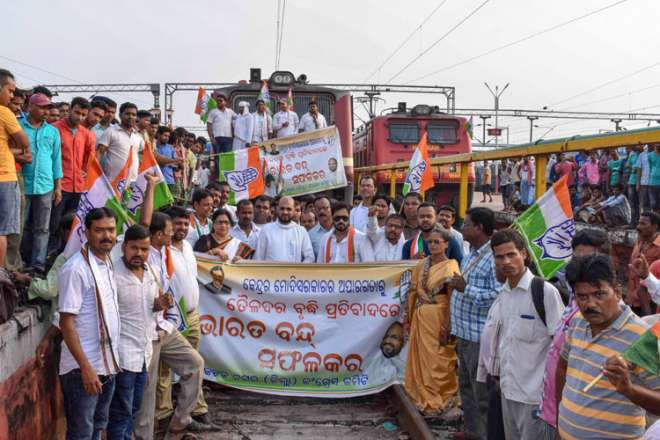 Congress workers stop a trains during the Bharat Bandh called over fuel price hike, at Cuttack Railway Station, in Cuttack