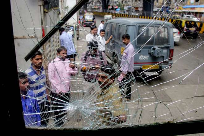 A bus that was vandalised by some unknown protesters during the Bharat Bandh, called over fuel price hike, in Mumbai