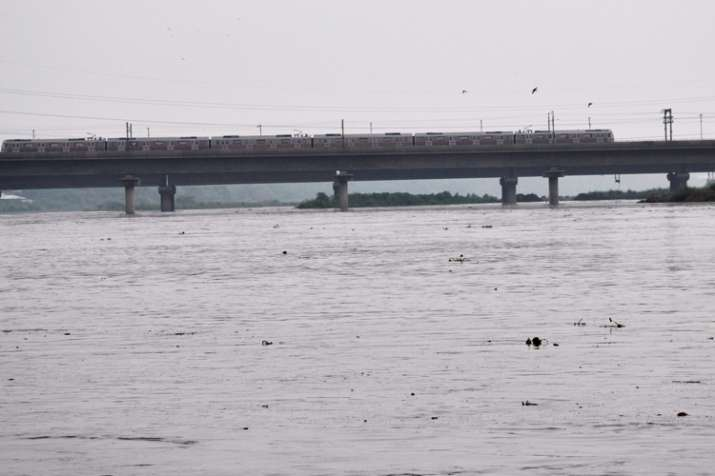 A view of the swollen Yamuna river as its water level rises near the Old Bridge, in New Delhi