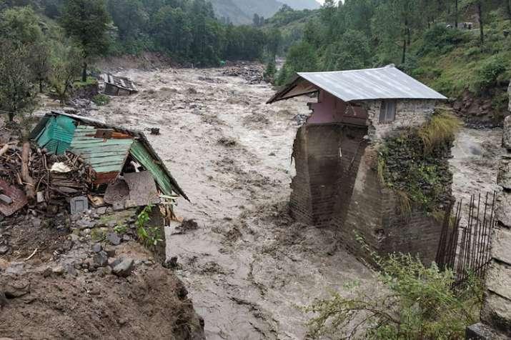 A swollen Beas river flows after heavy rains in the region, in Kullu district