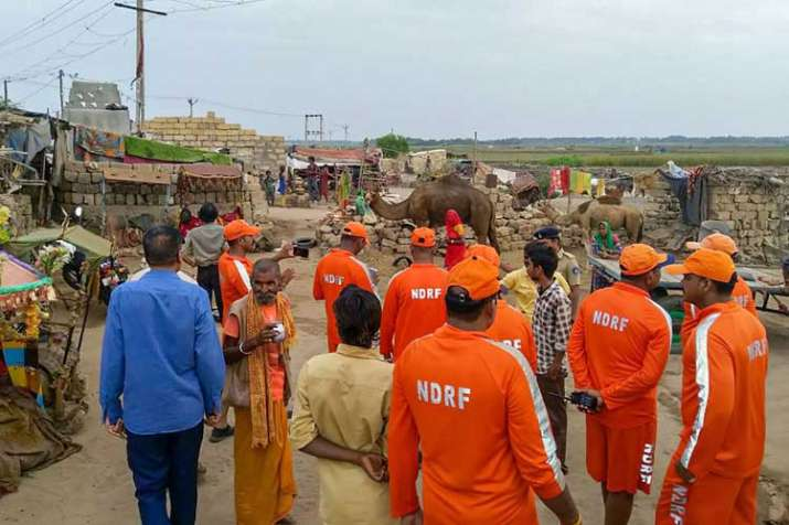 NDRF officials while carrying out an evacuation drive as Cyclone 'Vayu' advances towards the Gujarat coast, in Porbandar