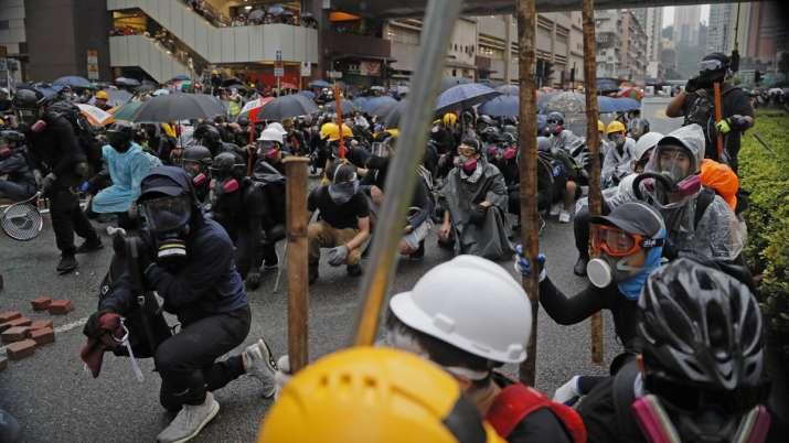 Hong Kong police arrest 36, youngest aged 12, after violent protests | AP