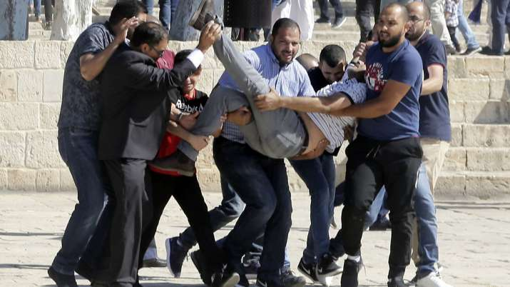 Palestinians and Israeli police clash at Al-Aqsa Mosque, 14 injured | AP