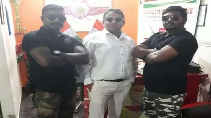 Salim Khan, owner of Bangalore Security Force with his two guards