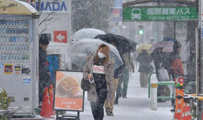 dozens injured in snow in Tokyo travelers stranded in the...- India TV