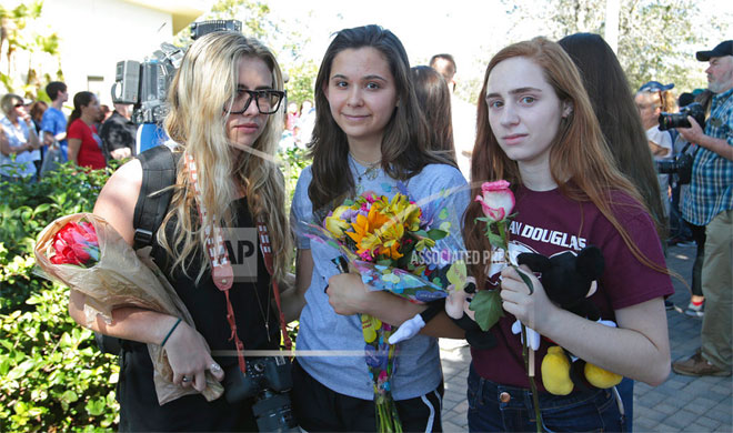 People hold vigil for victims of Florida school shooting | AP Photo- India TV