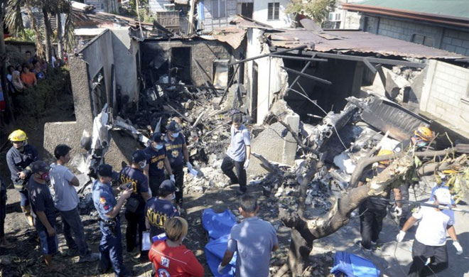 Philippines: 10 dead as small plane slams into house | AP Photo- India TV