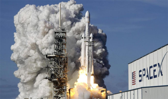 Elon Musk says SpaceX will launch rocket to Mars next year | AP Photo- India TV