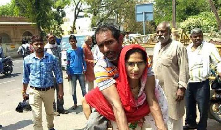 Woman in Mathura carries handicapped husband on shoulders to get disability certificate- India TV