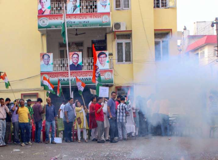Congress supporters celebrate after the resignation of...- India TV