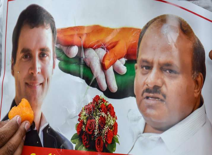 A poster of Congress President Rahul Gandhi and JD(S)...- India TV