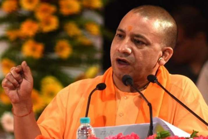 UP CM Yogi Adityanath cuts short Karnataka poll campaign, rushes back to UP to visit storm-hit areas- India TV