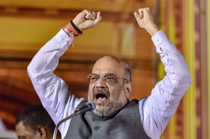 Cong merely talked of 'garibi hatao', Modi govt transformed lives of tribal, poor people: Shah- India TV