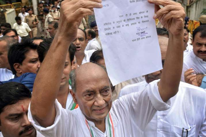 Digvijay Singh shows his clean-chit letter, obtained...- India TV