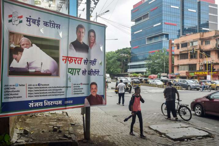 A hoarding with a picture of Congress president Rahul...- India TV
