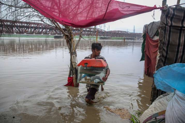 People shift their belongings to drier area as he...- India TV
