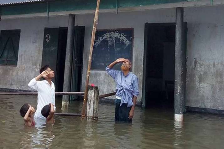 Boy who saluted Tricolour in chest-deep flood water not...- India TV