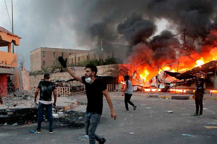 Iraq: 12 dead in Basra as rockets fired at airport and Iranian consulate torched | AP- India TV