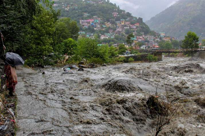 A swollen Beas river flows after heavy rains in the...- India TV