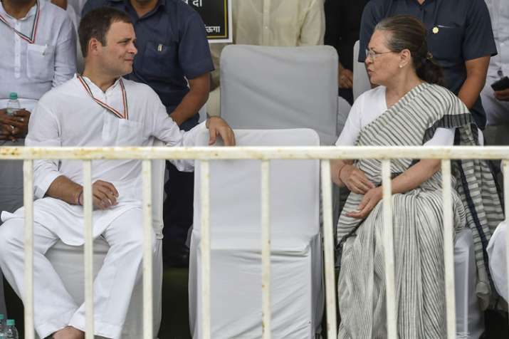 Former Congress president Sonia Gandhi (R) and...- India TV