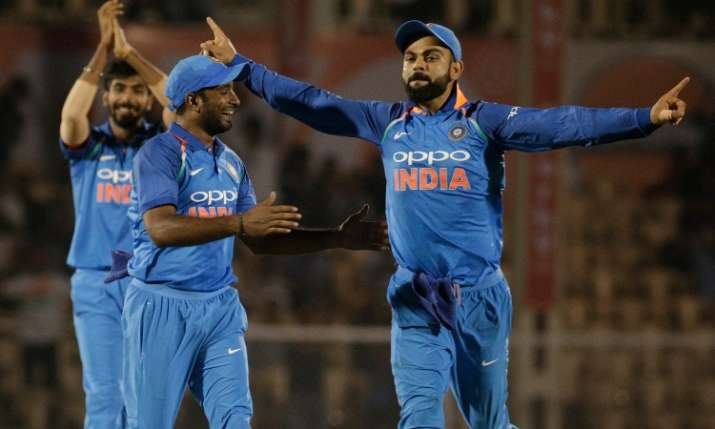 Virat Kohli celebrates with Ambati Rayudu and Jasprit Bumrah- India TV