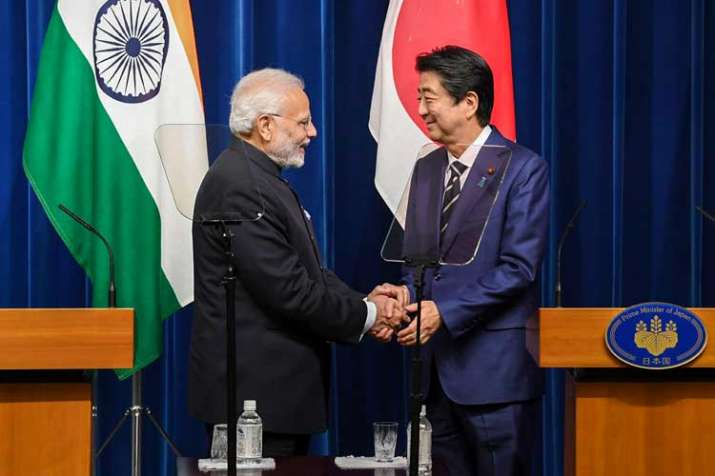 Prime Minister Narendra Modi shakes hands with his...- India TV Paisa