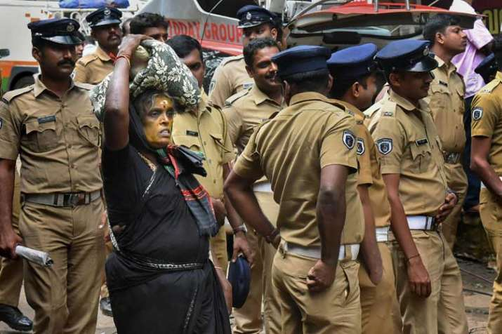 An elderly woman on her way to Sabarimala Temple as...- India TV