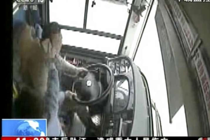 China: brawl between passenger and driver, bus plunged into river, 13 killed - India TV