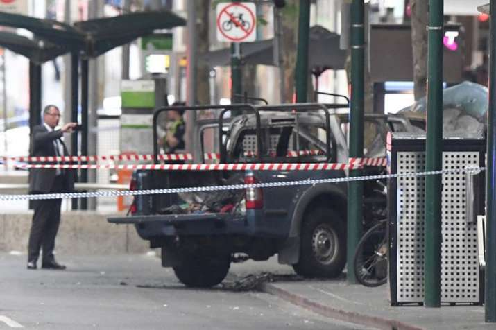 A burnt out vehicle is seen on Bourke Street in Melbourne, Friday, Nov. 9, 2018 | AP Photo- India TV