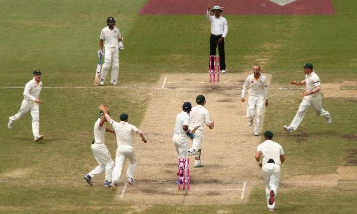 Nathan Lyon celebrates with other team mates- India TV