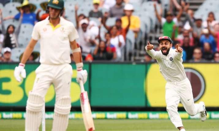 Virat Kohli celebrates after Pat Cummins wicket- India TV