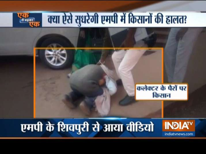 A farmer breaks down and falls to the feet of the newly appointed Collector in Shivpuri MP- India TV