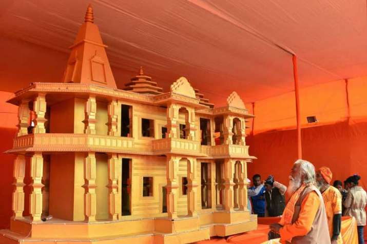 People look at a model of Ram Mandir, to be built in...- India TV