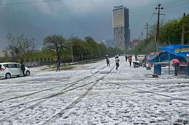 A view of a street after hailstorm struck various parts...- India TV