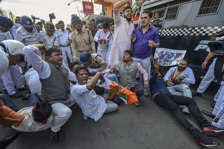 Police detain Youth Congress activists during a protest...- India TV