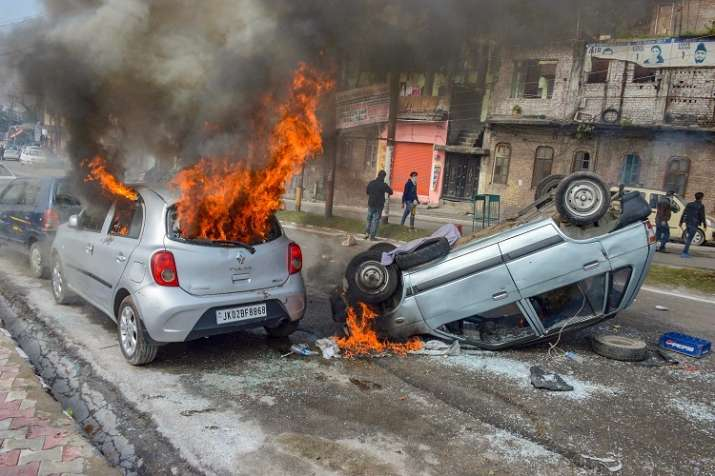 Vehicles set on fire by protestors against the killing...- India TV