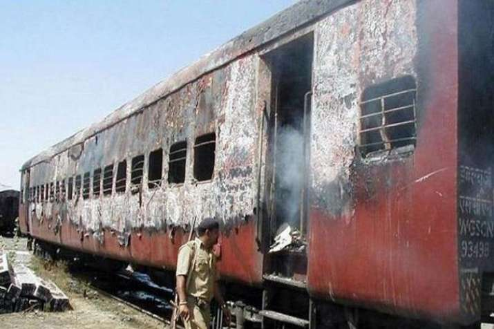 Coach S6 of the Sabarmati Express that was burnt on...- India TV