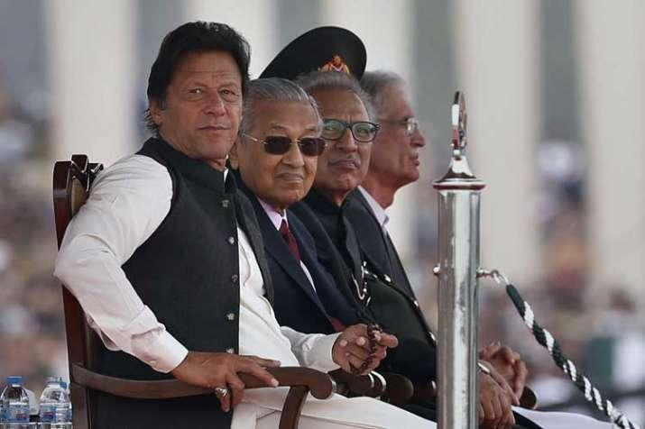 Malaysian Prime Minister Mahtir Mohamad, second left,...- India TV