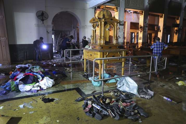 Shoes and other belongings left by panicked worshippers...- India TV