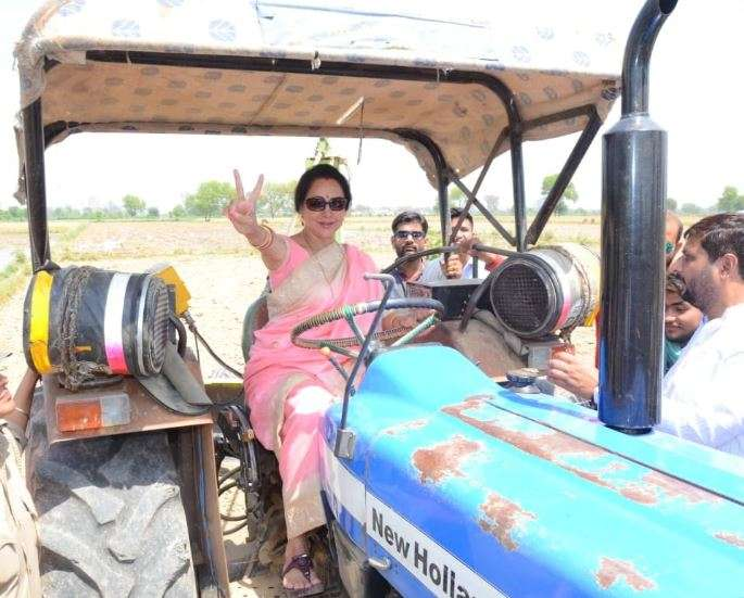 BJP MP and Mathura candidate Hema Malini drives a tractor in Govardhan- India TV