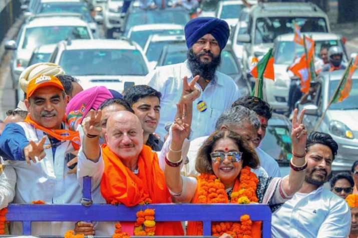 Bollywood actor and sitting MP Kirron Kher along with...- India TV