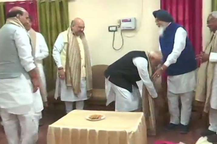 PM Narendra Modi touches feet of Parkash Singh Badal to seek his blessings before nominations| ANI- India TV