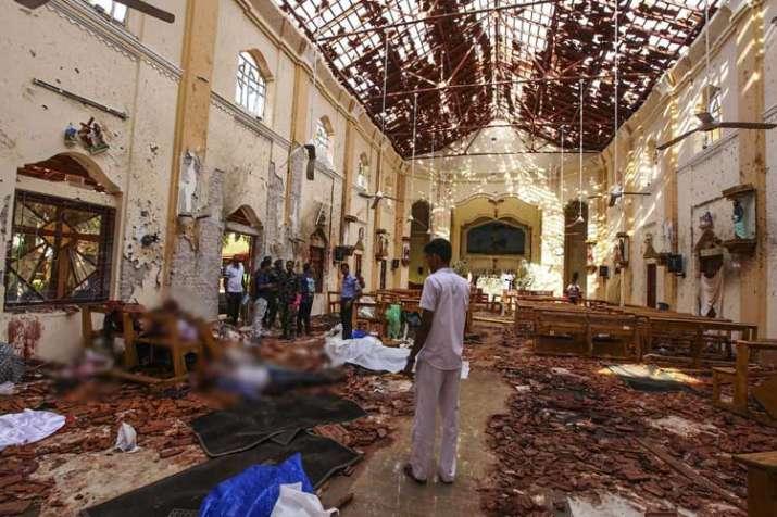 Dead bodies of victims lie inside St. Sebastian's Church...- India TV